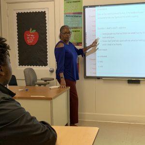 High school teacher teaching her class